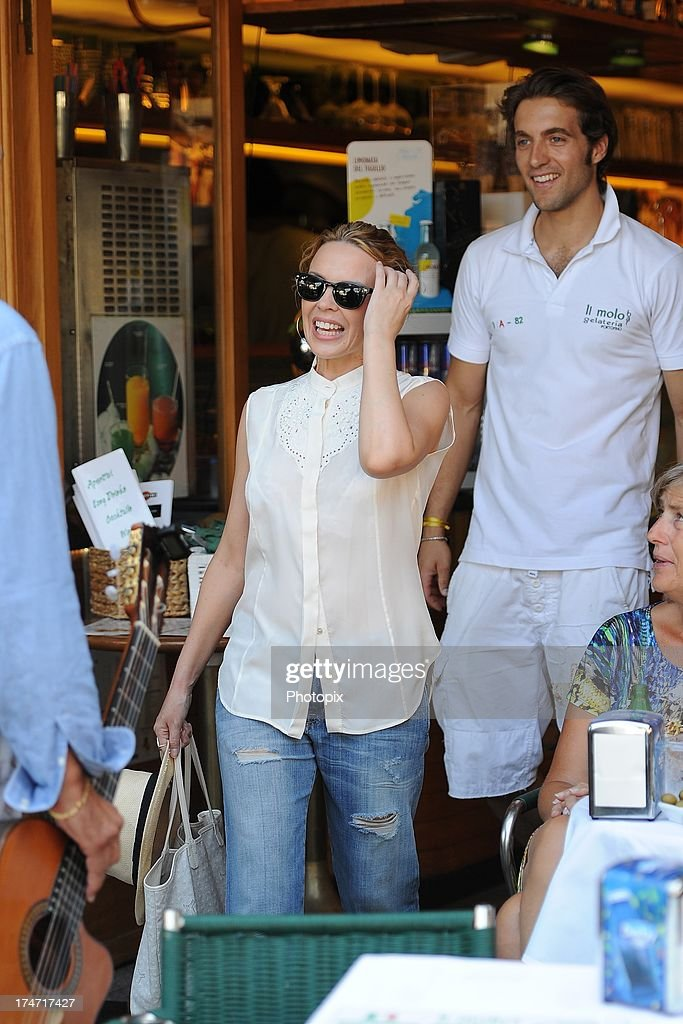 <a gi-track='captionPersonalityLinkClicked' href=/galleries/search?phrase=Kylie+Minogue&family=editorial&specificpeople=201671 ng-click='$event.stopPropagation()'>Kylie Minogue</a> is sighted on July 28, 2013 in Portofino, Italy. <a gi-track='captionPersonalityLinkClicked' href=/galleries/search?phrase=Kylie+Minogue&family=editorial&specificpeople=201671 ng-click='$event.stopPropagation()'>Kylie Minogue</a> is spending her holiday as a guest in Stefano Gabbana and Domenico Dolce's villa in Portofino.