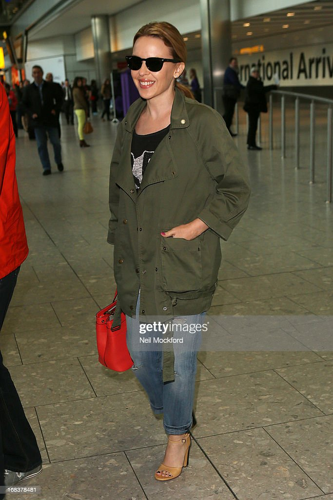 <a gi-track='captionPersonalityLinkClicked' href=/galleries/search?phrase=Kylie+Minogue&family=editorial&specificpeople=201671 ng-click='$event.stopPropagation()'>Kylie Minogue</a> is spotted arriving back at Heathrow after a trip to the U.S on May 9, 2013 in London, England.