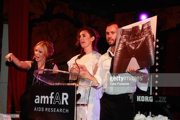 Kylie Minogue Mademoiselle Agnes and guest participate to the auction of the Amfar inspiration night at Maxim's on June 25 2010 in Paris France