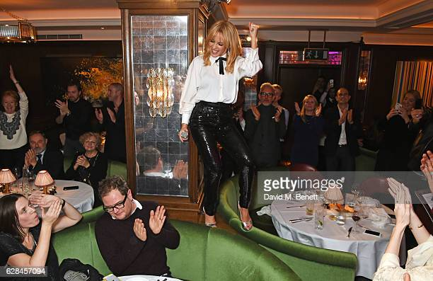 Kylie Minogue performs at an intimate performance at The Ivy to kick off The Ivy 100 Centenary celebrations on December 7 2016 in London England