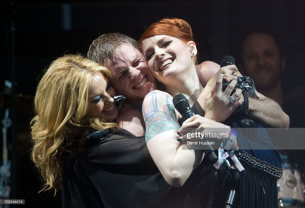 Kylie Minogue performs with Jake Shears and Ana Matronic of the Scissor Sisters on the Pyramid Stage at the Glastonbury Festival on June 26, 2010 in Glastonbury, England. Glastonbury has become Europe's largest music festival and is celebrating its 40th anniversary.