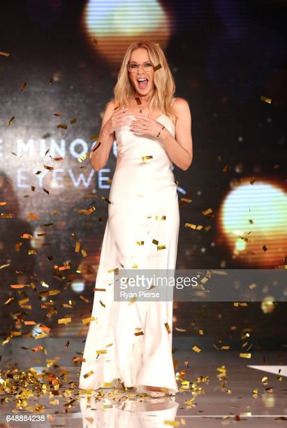 Kylie Minogue walks on stage at the launch of her eyewear collection for Specsavers at the Establishment Ballroom on March 7 2017 in Sydney Australia