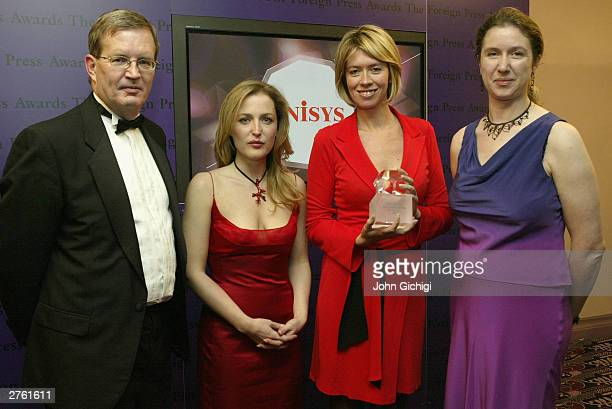 Kylie Morris of the BBC World Service is presented with the award for 'Radio Story of the year' by actress Gillian Anderson at the Foreign Press...