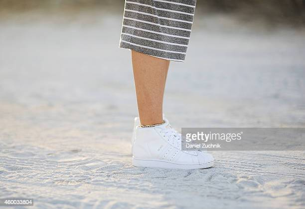Kylie Seurer is seen outside the Scope show wearing a vintage dress with Adidas sneakers on December 5 2014 in Miami Beach Florida