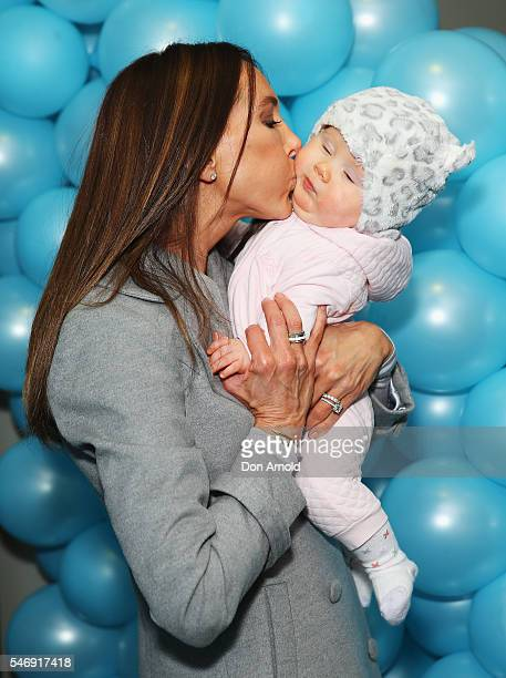 Kyly Clarke kisses daughter Kelsey Lee Clarke ahead of the Disney On Ice premiere at Qudos Bank Arena on July 13 2016 in Sydney Australia