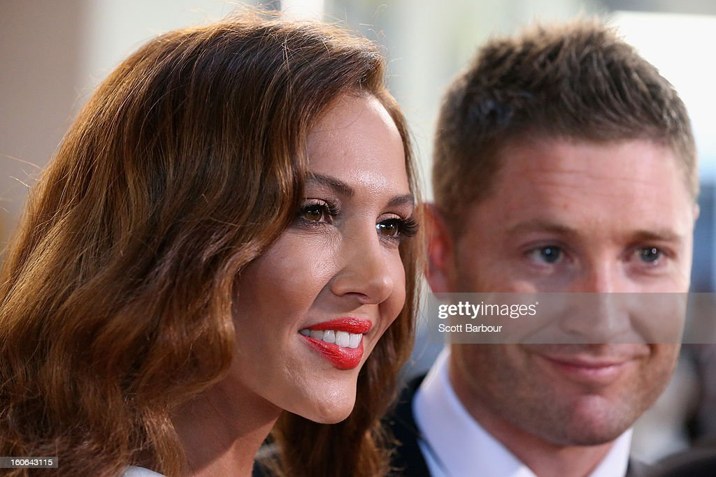 Kyly Clarke (L) looks on as her husband Michael Clarke of Australia speaks to the media as they arrive at the 2013 Allan Border Medal awards ceremony at Crown Palladium on February 4, 2013 in Melbourne, Australia.