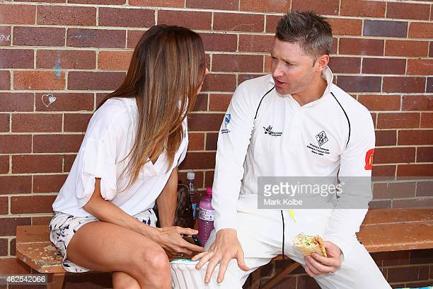 Kyly Clarke speaks with her husband Michael Clarke of Wests outside the dressing rooms during the lunch break as he bats in the Sydney Grade game...