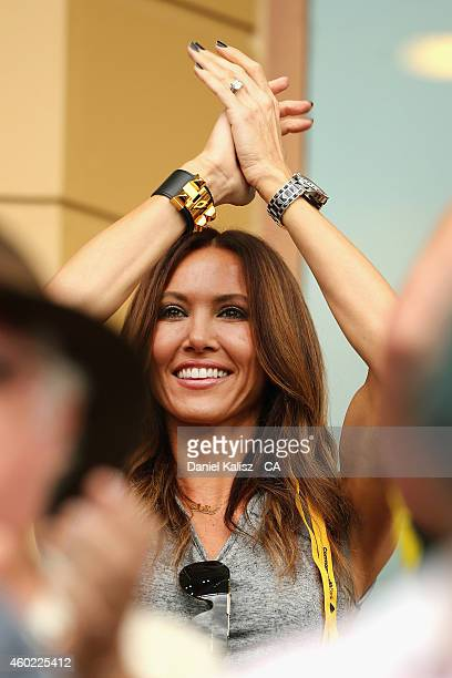 Kyly Clarke wife of Michael Clarke of Australia reacts after he scores his century during day two of the First Test match between Australia and India...