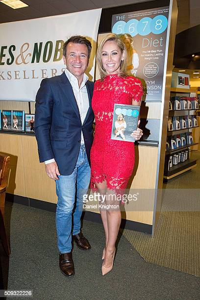 Kym Johnson of 'Dancing With The Stars' and Robert Herjavec of 'Shark Tank' appear at her book signing for 'The 5678 Diet' at Barnes Noble on...