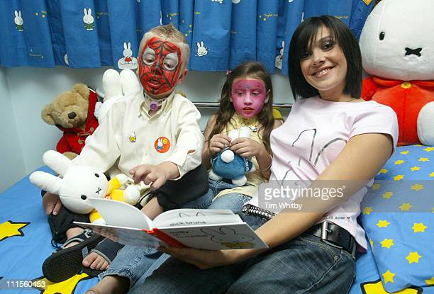 Kym Marsh visits Great Ormond Street Hospital September 2 2004 pictured with patient Chantelle Wilkes and Keelan Hewitt to celebrate the opening of...