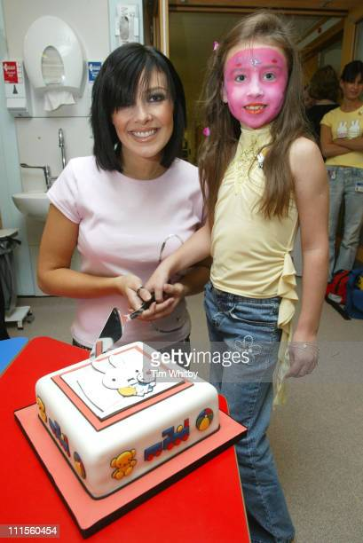 Kym Marsh visits Great Ormond Street Hospital September 2 2004 pictured with patient Chantelle Wilkes to celebrate the opening of the new Miffy Ward...