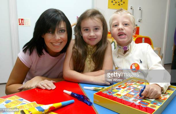 Kym Marsh visits Great Ormond Street Hospital September 2 2004 pictured with patients Chantelle Wilkes and Keelan Hewitt to celebrate the opening of...