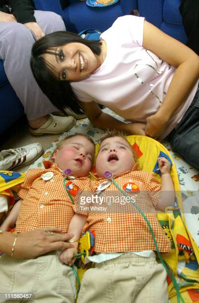Kym Marsh visits Great Ormond Street Hospital September 2 2004 pictured with patients Shaney and Chesney Wilkes to celebrate the opening of the new...