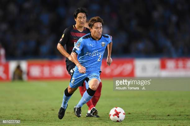 Kyohei Noborizato of Kawasaki Frontale controls the ball under pressure of Daigo Nishi of Kashima Antlers during the JLeague J1 match between...