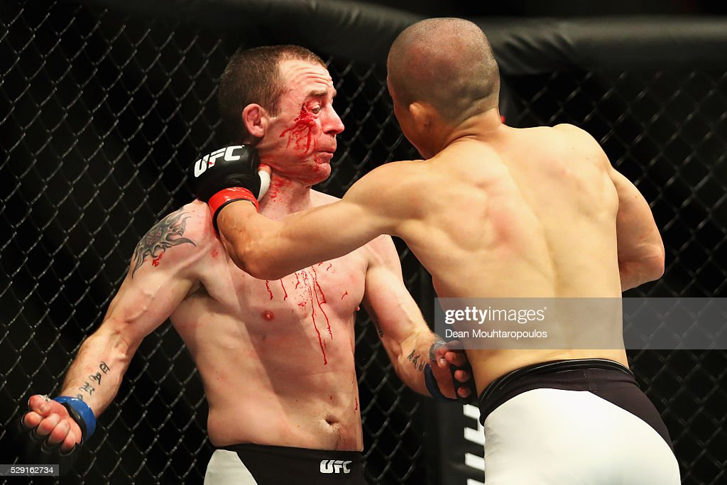 Kyoji Horiguchi (R) of Japan and Neil Seery of Ireland compete in their Flyweight bout during the UFC Fight Night 87 at Ahoy on May 8, 2016 in Rotterdam, Netherlands.