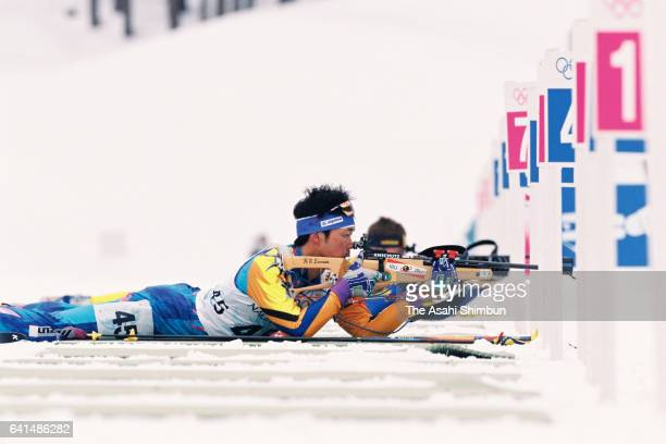 Kyoji Suga of Japan competes in the Biathlon Men's 10km Sprint during day eleven of the Nagano Winter Olympic Games at Nozawa Onsen Ski Resort on...