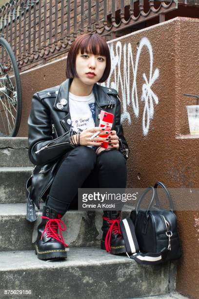 Kyoka Komatsu is wearing a 666 punk rock leather black jacket a Seditionaries graphic white tshirt Hysteric Glamour black jeans Dr Martens Black...