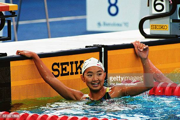 Kyoko Iwasaki of Japan celebrates winning the gold in the Women's 200m Breaststroke during the Barcelona Summer Olympic Games at Piscines Bernat...