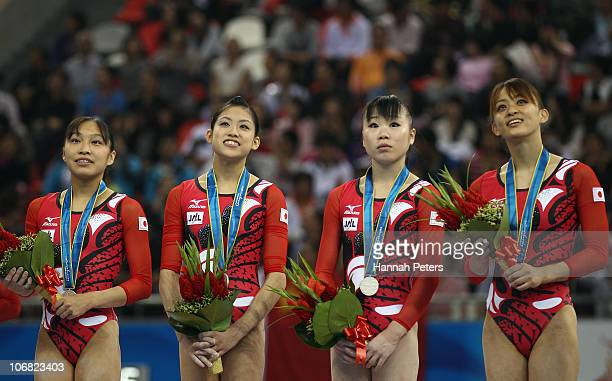 Kyoko Oshima Yuko Shintake Momoko Ozawa and Rie Tanaka of Japan celebrate winning silver after competing in the Women's Team Final at the Asian Games...