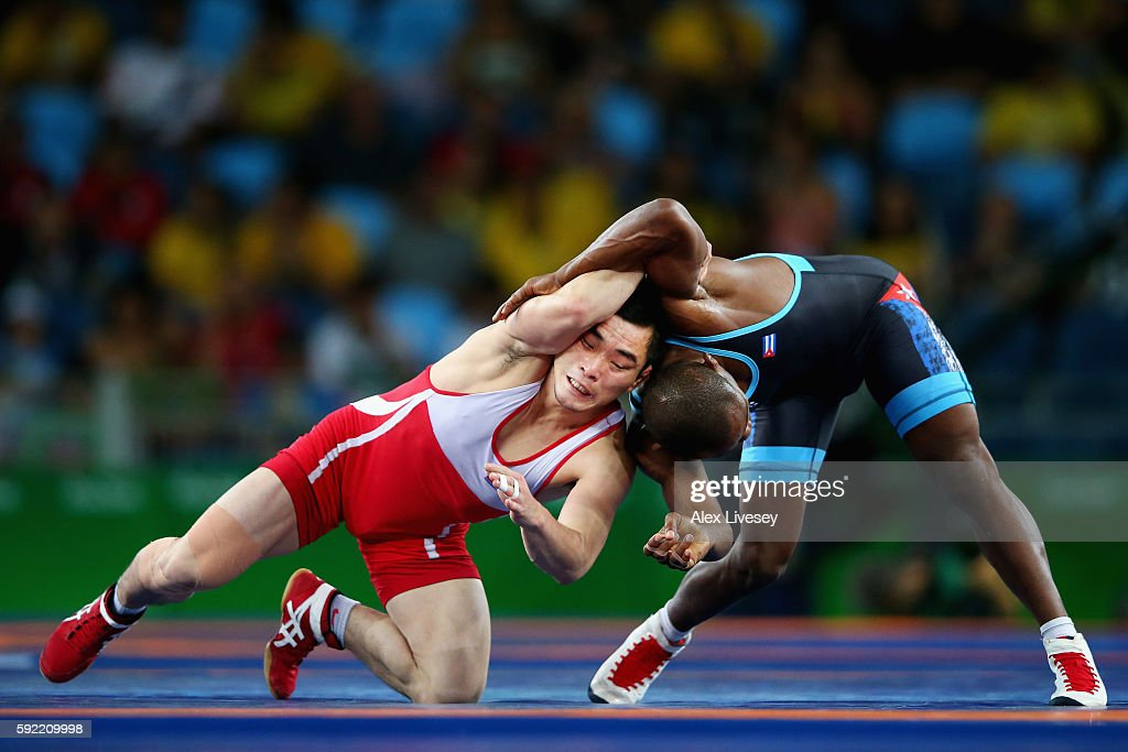 Kyong Il Yang of North Korea competes against Yowlys Bonne Rodriguez of Cuba during the Men's 57kg Repechage Wrestling match on Day 14 of the Rio 2016 Olympic Games at Carioca Arena 2 on August 19, 2016 in Rio de Janeiro, Brazil.