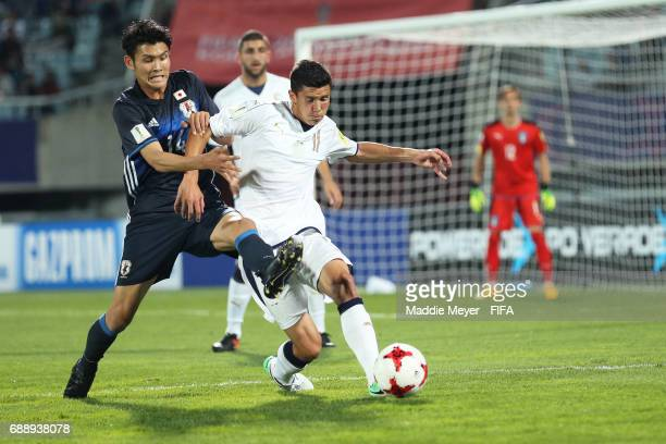 Kyosuke Tagawa of Japan challenges Matteo Pessina of Italy during the FIFA U20 World Cup Korea Republic 2017 group D match between Japan and Italy at...
