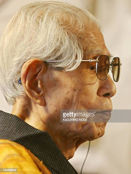 Master weaver Itaro Yamaguchi who made Nishijin silk reproductions of the illustrated Tale of Genji handscrolls looks on in Kyoto 08 June 2007 The...