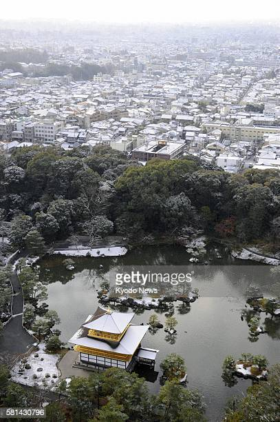 Kyoto Japan The Kinkakuji a Zen Buddhist temple in Kyoto western Japan is lightly dusted with snow with the city of Kyoto seen in the background in...