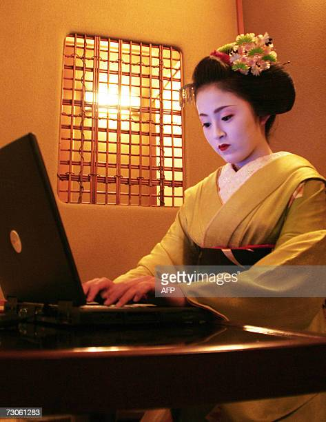 TO WITH STORY AFPLIFESTYLEJAPANCULTUREGEISHA Ichimaru an 18yearold maiko or young geisha sits at her computer at a Kyoto teahouse where she has been...
