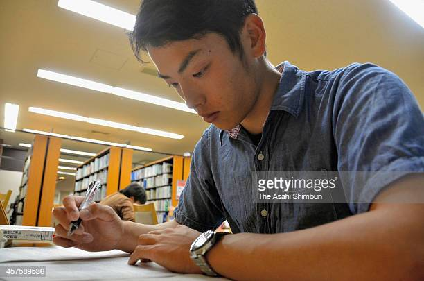 Kyoto University pitcher Eisuke Tanaka studies at Kyoto University Library on May 19 2014 in Kyoto Japan Tanaka is a senior student of Kyoto...