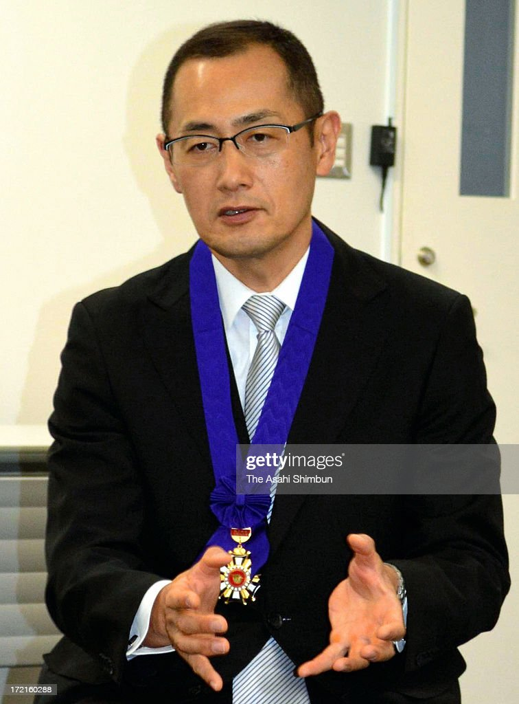 Kyoto University professor and Nobel Prize laureate Shinya Yamanaka speaks to media reporters after receiving Honorary Ctizen of Higashi Osaka City...