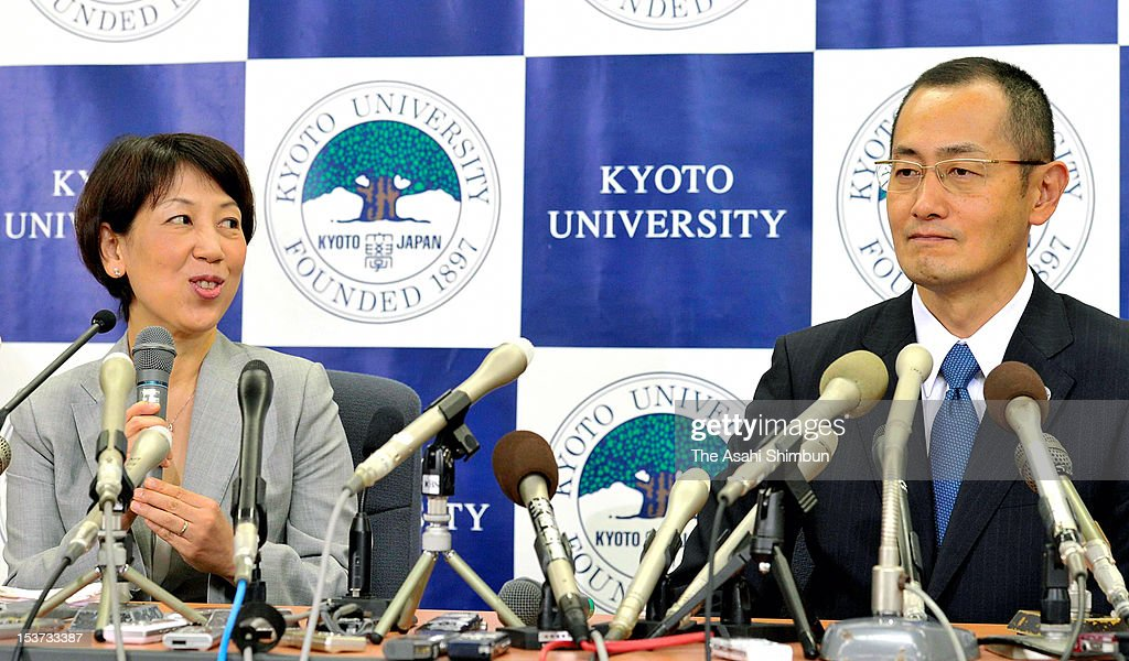 Kyoto University Professor <a gi-track='captionPersonalityLinkClicked' href=/galleries/search?phrase=Shinya+Yamanaka&family=editorial&specificpeople=4810477 ng-click='$event.stopPropagation()'>Shinya Yamanaka</a> (R) listens to his wife Chika speaking during a press conference at Kyoto University on October 9, 2012 in Kyoto, Japan. Yamanaka and Sir John Gurdon have both been awarded the Nobel prize for medicine or physiology for their work as pioneers of stem cell research.