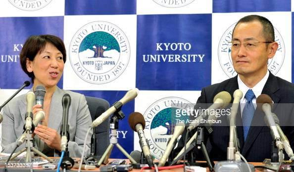 Kyoto University Professor Shinya Yamanaka listens to his wife Chika speaking during a press conference at Kyoto University on October 9 2012 in...