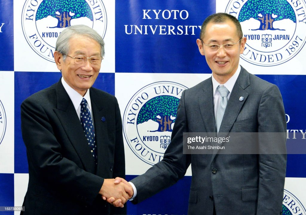 Kyoto University Professor <a gi-track='captionPersonalityLinkClicked' href=/galleries/search?phrase=Shinya+Yamanaka&family=editorial&specificpeople=4810477 ng-click='$event.stopPropagation()'>Shinya Yamanaka</a> (R) shakes hands with Kyoto University president Hiroshi Matsumoto during a press conference at Kyoto University on October 8, 2012 in Kyoto, Japan. Yamanaka and Sir John Gurdon of the United Kingdom have both been awarded the Nobel prize for medicine or physiology for their work as pioneers of stem cell research.