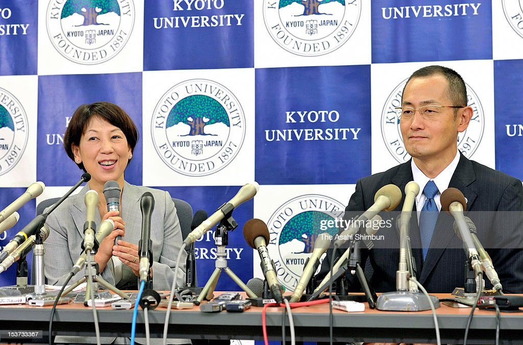 Kyoto University Professor <a gi-track='captionPersonalityLinkClicked' href=/galleries/search?phrase=Shinya+Yamanaka&family=editorial&specificpeople=4810477 ng-click='$event.stopPropagation()'>Shinya Yamanaka</a> (R) smiles as his wife Chika (L) speaks during a press conference at Kyoto University on October 9, 2012 in Kyoto, Japan. Yamanaka and Sir John Gurdon have both been awarded the Nobel prize for medicine or physiology for their work as pioneers of stem cell research.