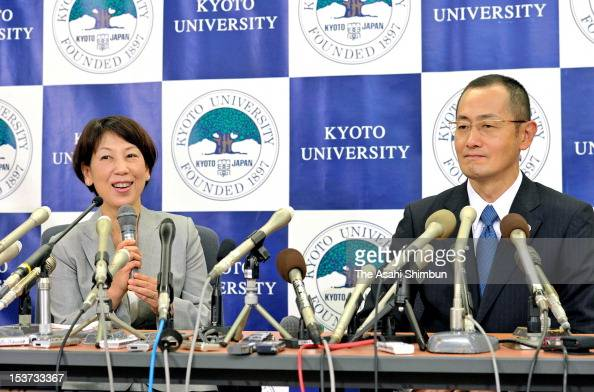 Kyoto University Professor Shinya Yamanaka smiles as his wife Chika speaks during a press conference at Kyoto University on October 9 2012 in Kyoto...