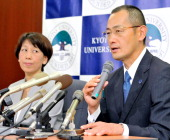 Kyoto University Professor Shinya Yamanaka speaks while his wife Chika smiles during a press conference at Kyoto University on October 9 2012 in...