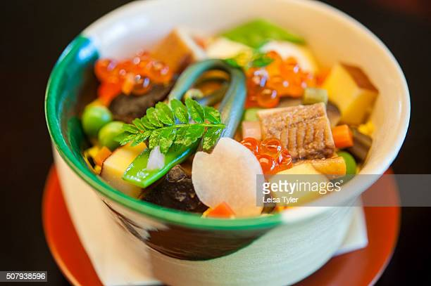 Kyotostyle chirashi sushi at Kikunoi the three Michelin star fine dining kaiseki restaurant of chef Yoshihiro Murata one of Japans most acclaimed...