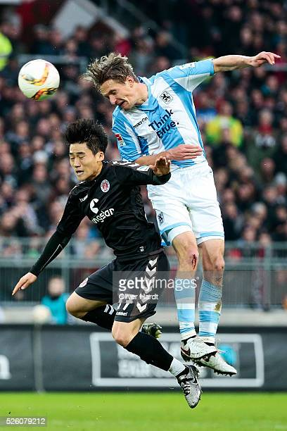 Kyoung Rok Choi of Hamburg and Kai Buelow of Muenchen compete for the ball during the Second Bundesliga match between FC St Pauli and 1860 Muenchen...