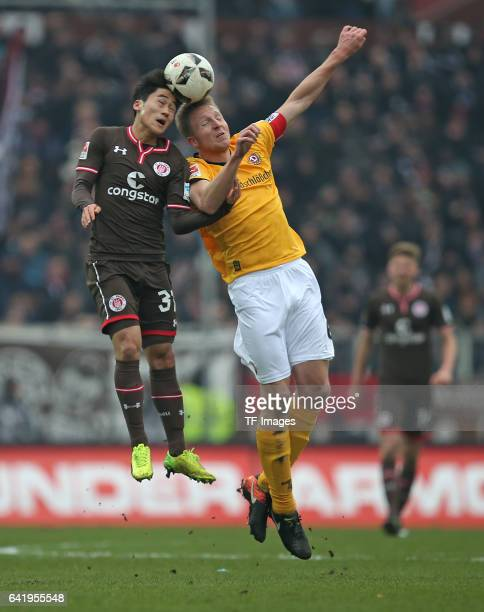 KyoungRok Choi of St Pauli and Marco Hartmann of Dynamo Dresden battle for the ball during the Second Bundesliga match between FC St Pauli and SG...