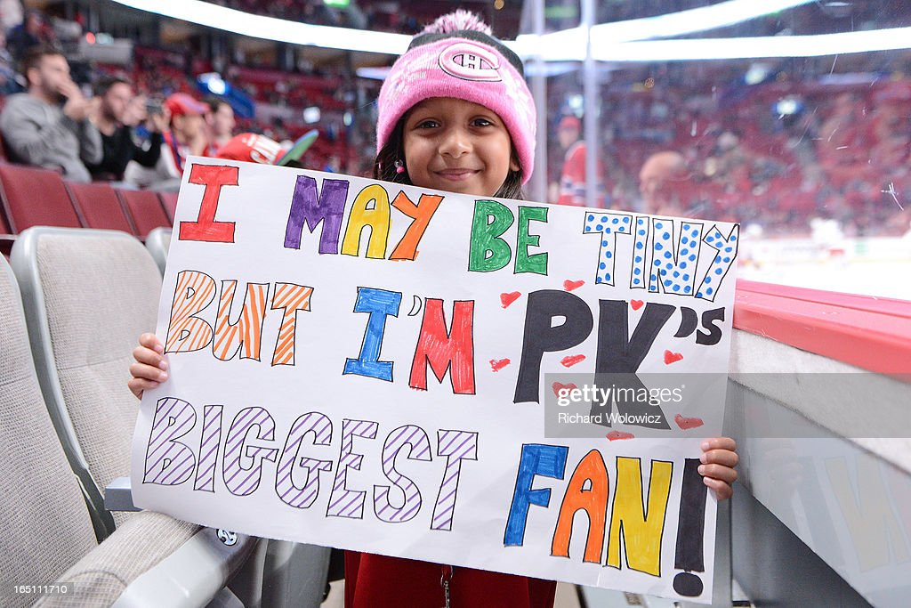 Kyra Bhakti of Pickering, Ontario holds a sign supporting her favourite Montreal Canadiens prior to the NHL game between the Montreal Canadiens and the New York Rangers at the Bell Centre on March 30, 2013 in Montreal, Quebec, Canada.