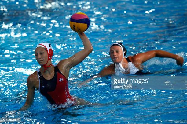 Kyra Christmas of Canada shoots on goal during the Women's Water Polo preliminary round match between Canada and New Zealand on day nine of the...