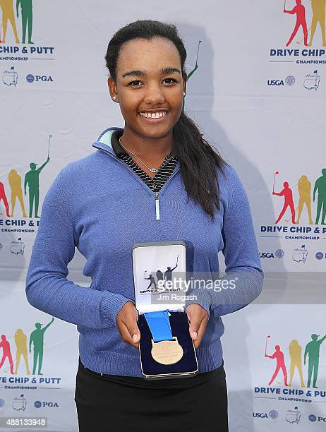Kyra Cox first place winner in the Girls 1415 driving competition poses with her medal during the 2015 Drive Chip and Putt Championship at The...