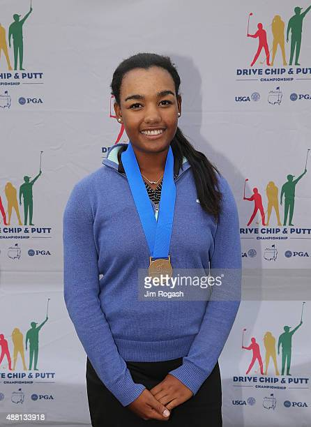 Kyra Cox first place winner in the Girls 1415 overall competition poses with her medal during the 2015 Drive Chip and Putt Championship at The...