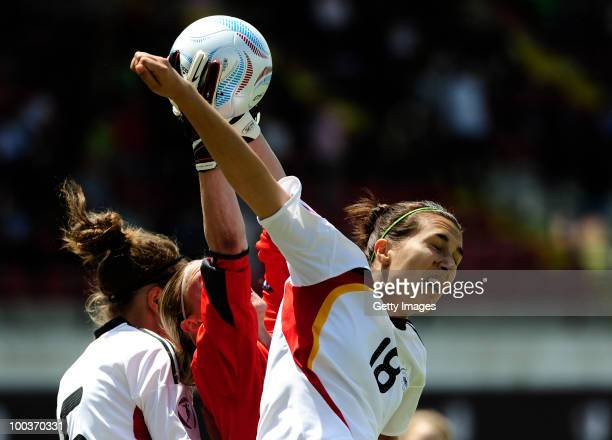 Kyra Malinowski of Germany fights for the ball with Katia Schroffenegger of Italy during the UEFA Women's Under19 European Championship group A match...