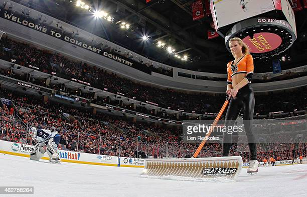Kyra Marie Grande of the Philadelphia Flyers ice girls cleans the ice during a timeout against the Winnipeg Jets on January 29 2015 at the Wells...