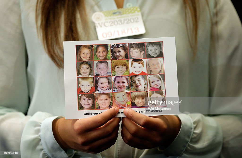Kyra Murray holds a photo with victims of the shooting at Sandy Hook Elementary School during a press conference at the US Capitol calling for gun...