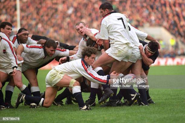 Kyran Bracken releases the ball from a ruck during his debut for England Also pictured for England Martin Johnson Steve Ojomoh Jason Leonard Dean...