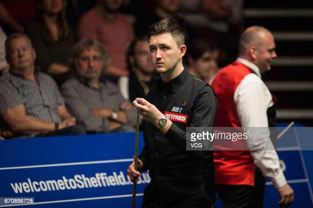 Kyren Wilson of England chalks the cue during his second round match against Stuart Bingham of England on day six of Betfred World Championship 2017...