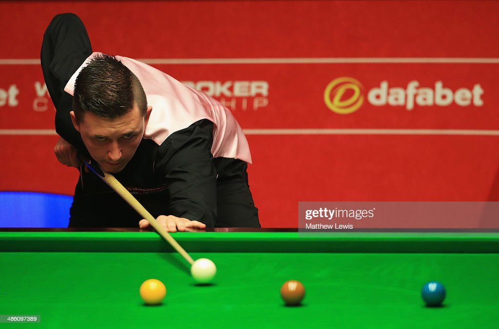Kyren Wilson of England in action agsint Ricky Walden of England during day four of the The Dafabet World Snooker Championship at Crucible Theatre on April 21, 2014 in Sheffield, England.