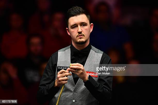 Kyren Wilson of England looks on during his first round match against Ding Junhui of China on day one of the Dafabet Masters at Alexandra Palace on...